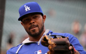 Howie Kendrick plays catch during batting practice.